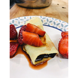 Crepes Filled with Strawberries and Chocolate Fudge Sauce