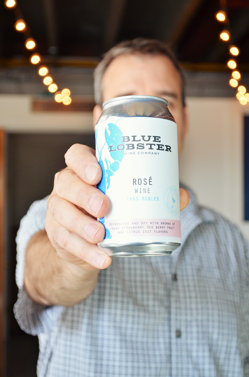 Chris Gamble Holding canned rose