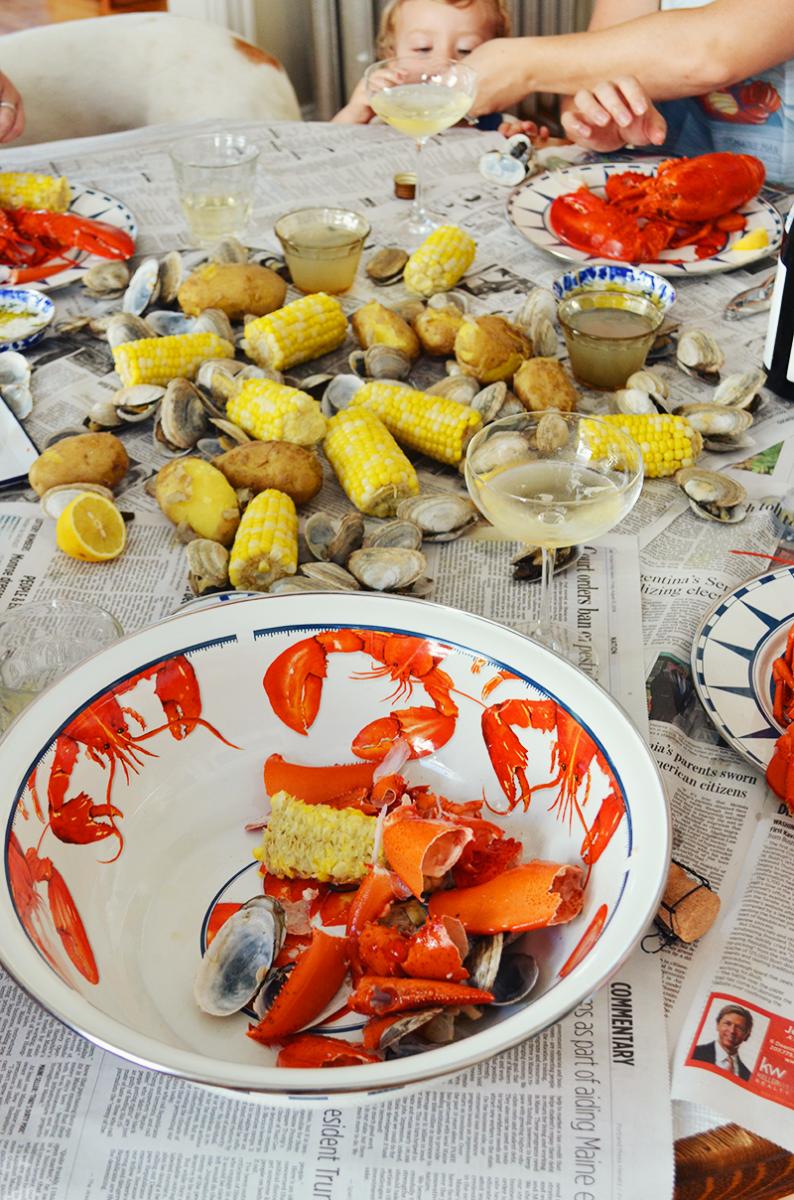 enjoying a lobster boil with golden rabbit enamelware
